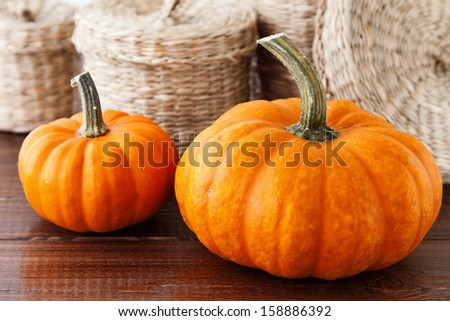 Fresh pumpkins on a wooden table