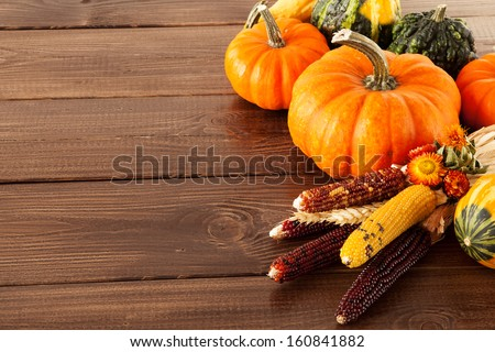 Fresh pumpkins on a wooden table - stock photo
