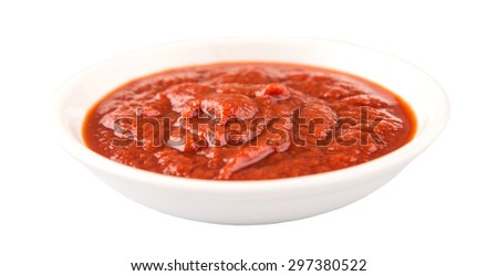 Fresh pureed tomato in white bowl over white background - stock photo