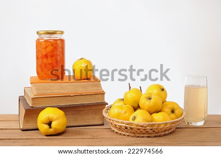 Fresh quince jam and juice on the table - stock photo