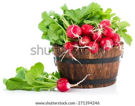 Fresh radish with green leaves in wooden bucket. Isolated on white background - stock photo