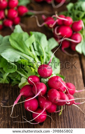 Fresh Radishes on wooden background (selective focus; close-up shot) - stock photo