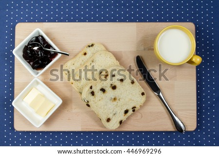 Fresh raisin bread with a cup of milk