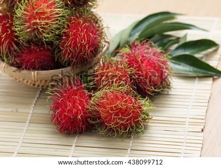 Fresh rambutan on wooden table,Fresh Thai rambutan. - stock photo