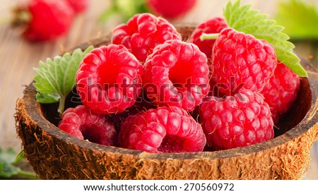 Fresh raspberries  on a wooden table .Selective focus - stock photo