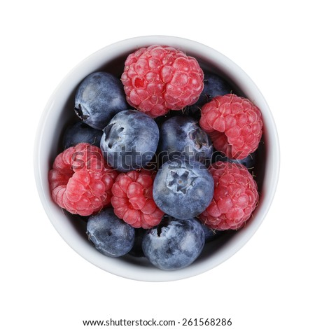 fresh raspberry and blueberry in bowl directly above - stock photo