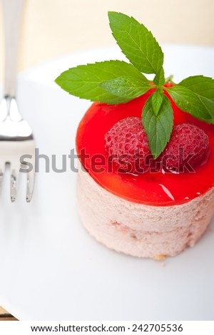 fresh raspberry cake mousse dessert round shape with mint leaves - stock photo