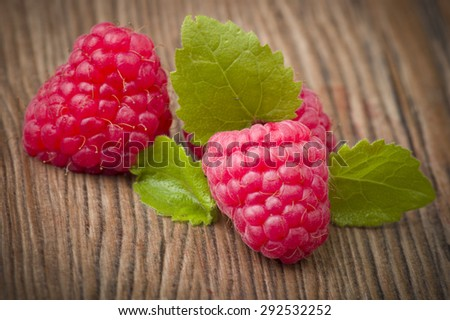 Fresh Raspberry close up on the wood table - stock photo