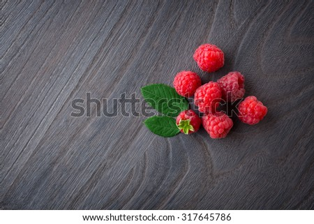 Fresh  raspberry on wood background - stock photo