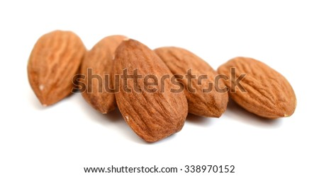 fresh raw almonds isolated on white  - stock photo