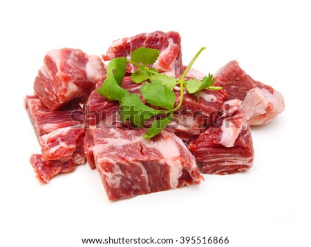 fresh raw beef cubes isolated on white  - stock photo