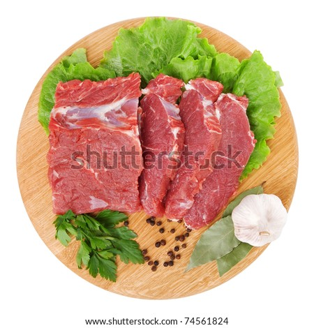 fresh raw beef steak meat on cutting board in closeup over white background - stock photo