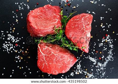 Fresh Raw Beef steak Mignon, with salt, peppercorns, thyme. - stock photo