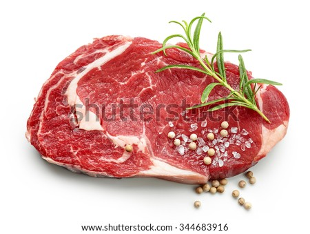 fresh raw beef steak with spices isolated on white background, top view - stock photo
