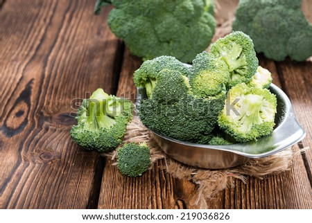 Fresh raw Broccoli as detailed close-up shot on wooden background - stock photo