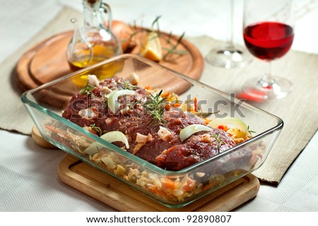 fresh raw deer meat in a glass bowl - stock photo