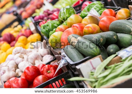 fresh raw different vegetables in market - stock photo