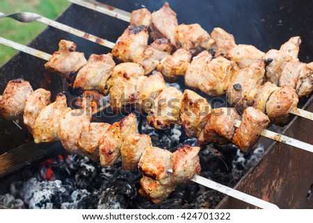 fresh raw  fillet steak  meat brisket on skewers barbecue brazier grid full burned charcoal - stock photo