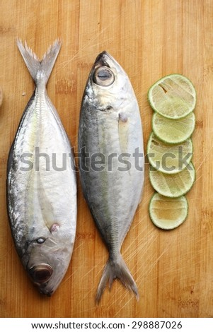Fresh raw fish with lemon - stock photo
