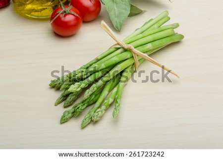Fresh Raw green asparagus on the wood background - stock photo