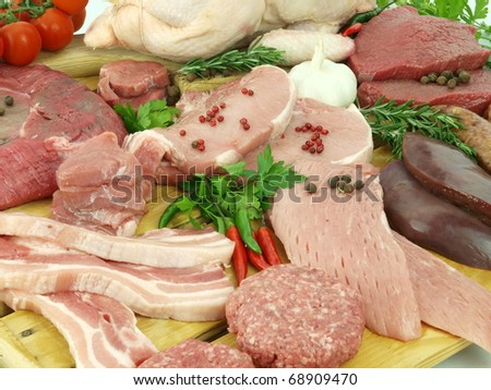 Fresh raw meat in a butcher shop - stock photo