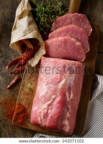 fresh raw meat on wooden cutting board - stock photo