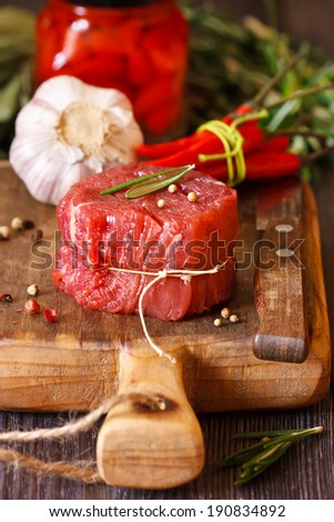 Fresh raw meat with spices close-up. - stock photo
