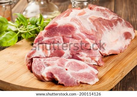 Fresh raw pork on cutting board - stock photo