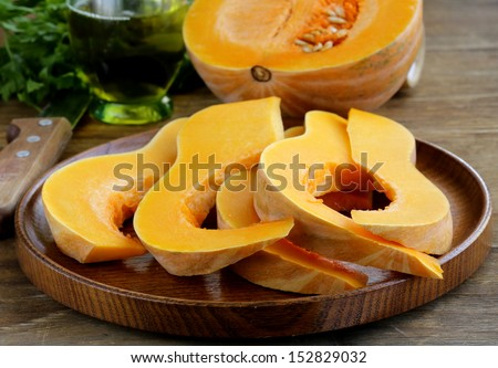 fresh raw pumpkin on a wooden table