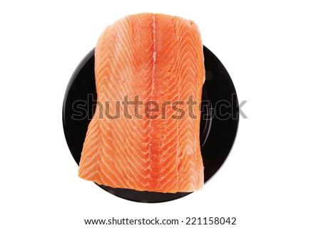 fresh raw salmon fillet on black over white - stock photo