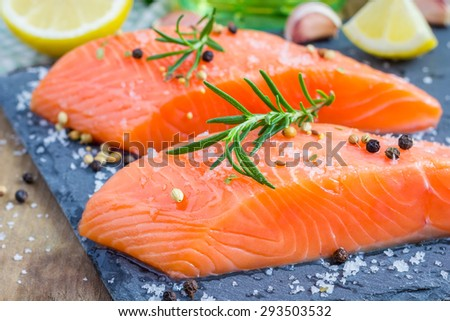 Fresh raw salmon fillet with seasonings - stock photo