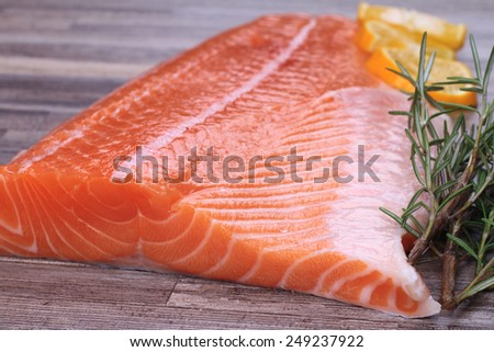 Fresh raw salmon on wooden table