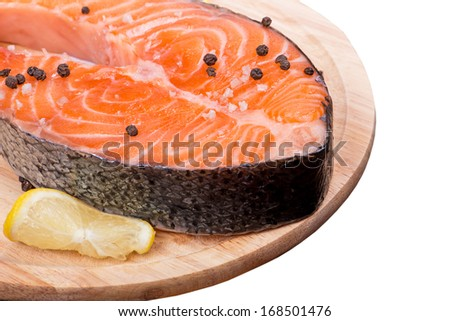 Fresh raw salmon red fish steak with herbs and spices - stock photo