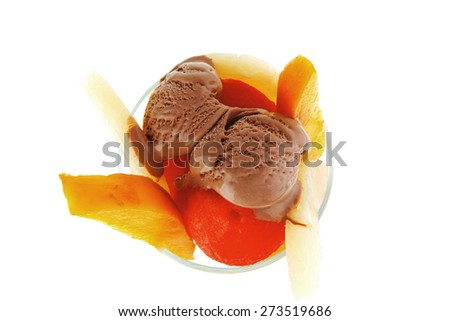 fresh raw  tropical fruits with chocolate ice cream in big glass isolated on white background - stock photo