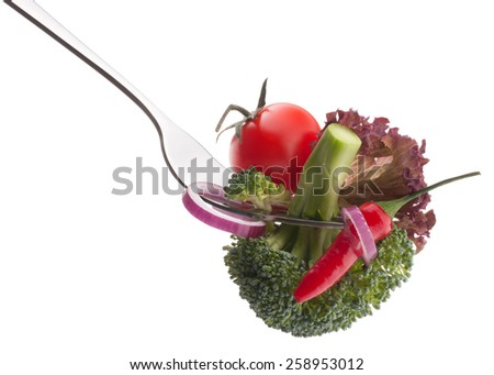 Fresh raw vegetables on fork isolated on white background cutout. Healthy eating concept. - stock photo