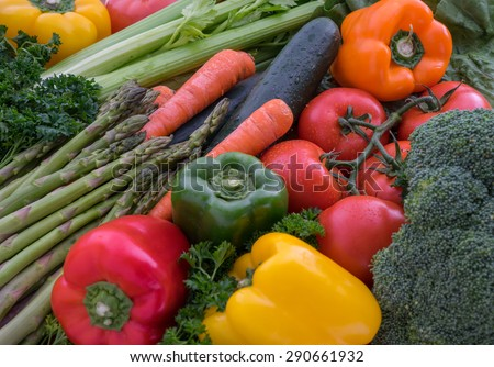 Fresh raw vegetables - tomatoes, peppers, carrots, broccoli, asparagus, celery - stock photo
