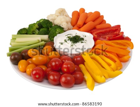 Fresh raw vegetables with dip on a plate
