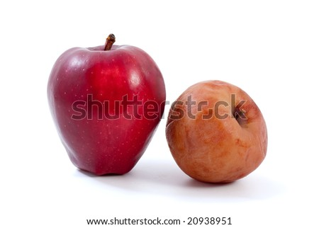 Fresh red and brown rotten apples isolated on the white background