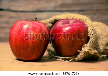 Fresh red apple on wooden background