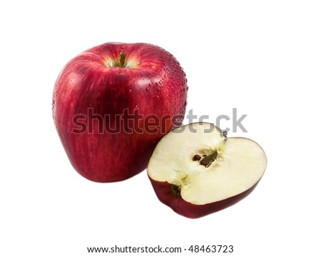 Fresh red apple with part of it