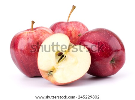 Fresh red apples sliced, isloated on white background closeup