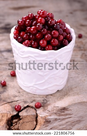 fresh red berries on wooden table. Selective focus - stock photo