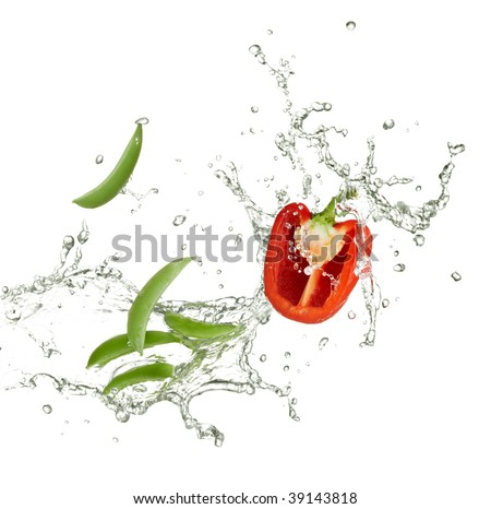 fresh red capsicum and peas with water splash - stock photo