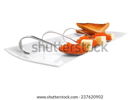 fresh red caviar served on teaspoon on plate - stock photo
