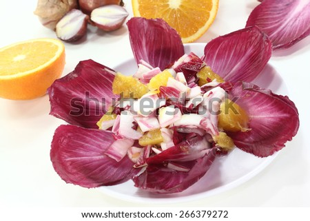 fresh red chicory salad with orange slices and dressing