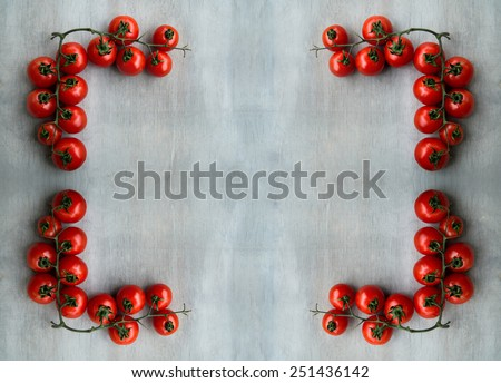 fresh red delicious tomatoes on old wooden tabletop background with place for text. Selective focus, close up.  - stock photo