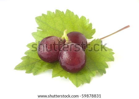 fresh red grape anf green leaf - stock photo