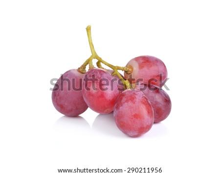 Fresh red grape on white background - stock photo