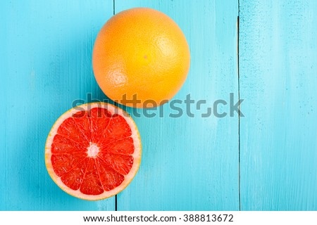 Fresh Red Grapefruit Slice On Table - stock photo