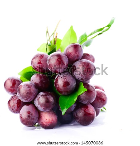 Fresh red grapes isolated on white background. - stock photo